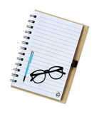 Notebook with pen and glasses isolated on white Stock Photography