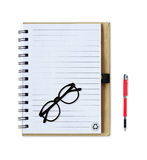 Notebook with pen and glasses isolated on white Stock Image