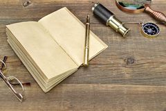 Notebook, Pen, Glasses, Magnifier, Cpmpass and Spyglass On Wood Royalty Free Stock Photos