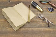 Notebook, Pen, Glasses, Magnifier, Cpmpass and Spyglass On Wood Royalty Free Stock Photo