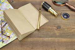 Notebook, Pen, Glasses, Magnifier, Cpmpass and Spyglass On Wood Royalty Free Stock Image