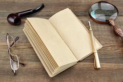 Notebook, Pen, Glasses, Magnifier and Smoking Pipe Royalty Free Stock Image