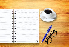 Notebook with pen and glasses  on wood Stock Photography