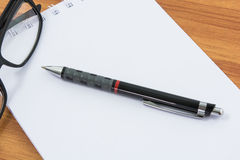 Notebook, pen and glasses Royalty Free Stock Photos
