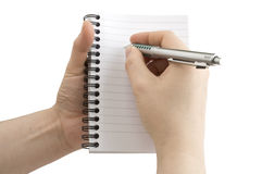 Notebook and pen in hand Stock Images