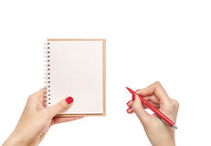 Notebook and pen in hand. Royalty Free Stock Photography