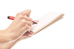 Notebook and pen in hand. Stock Photography