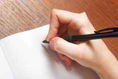 Notebook and pen in hand.  on white background. Royalty Free Stock Photo