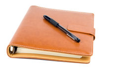 Notebook and pen isolated Royalty Free Stock Photos