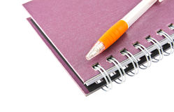 Notebook and pen isolated on white Royalty Free Stock Photos