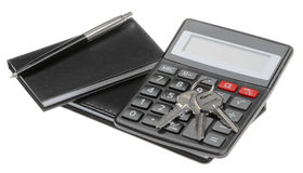 Notebook, pen, key and black calculator Royalty Free Stock Image