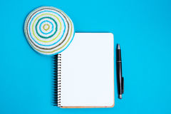 Notebook, pen and kipa on a blue background, top view. Jewish New Year, Rosh Hashanah. Stock Images