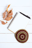 Notebook, pen and kipa on a white wooden background, top view. Jewish New Year, Rosh Hashanah Royalty Free Stock Images