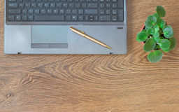 Notebook with pen, notebook and flower on a wooden table. Stock Photo