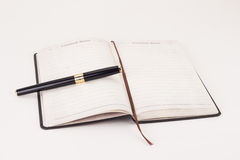 Notebook and a pen Stock Image