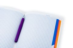 Notebook and pen for notes. Purple pen in an open notebook in cell Royalty Free Stock Photography
