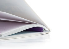 Notebook and pen for notes. Handle in the closed notebook, white background Stock Photos