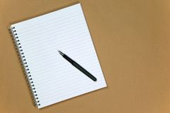 Notebook and pen on paper background Stock Photo