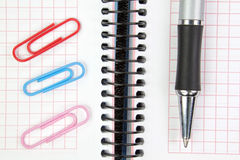 Notebook, pen and paper clips. Royalty Free Stock Image