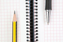 Notebook with pen and pencil. Royalty Free Stock Images