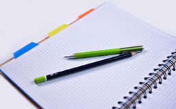 Notebook with pen and pencil Royalty Free Stock Image