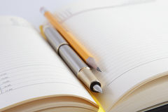 Notebook, pen with pencil Royalty Free Stock Images