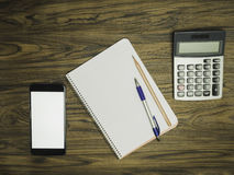 Notebook with pen and pencil. On top table royalty free stock images