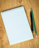 Notebook, pen and pencil Royalty Free Stock Photos