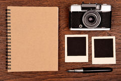 Notebook with pen, photo frames and camera Stock Images