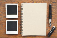 Notebook with pen and photo frames Stock Image