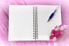 Notebook and pen on a pink background Stock Photos