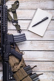 Notebook with pen and rifle Royalty Free Stock Photo