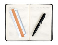 Notebook with pen and rule Stock Images