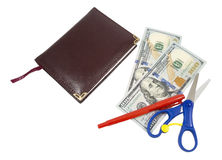 Notebook, pen, scissors and dollars Royalty Free Stock Photo