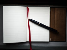 Notebook with a pen Royalty Free Stock Images