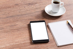 Notebook with pen, smart phone and coffee cup Royalty Free Stock Images