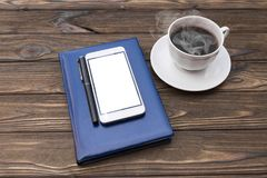 Notebook, pen, smartphone, coffee cup stock photography