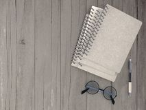 Notebook with pen and spectacles Stock Image