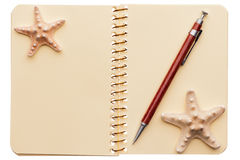 Notebook, pen, starfishes Stock Photography