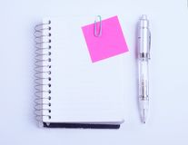 Notebook, pen and sticky note Royalty Free Stock Photo
