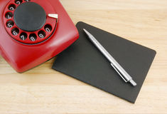 Notebook, pen and telephone Stock Photography