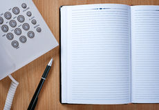 Notebook and Pen on Telephone Operator Table Stock Photography
