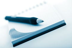 Notebook and pen toned blue Royalty Free Stock Image