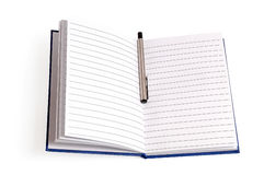 Notebook with pen on white Stock Images