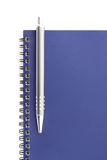 Notebook with pen on white background Royalty Free Stock Image