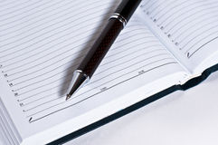 Notebook and pen. On a white background royalty free stock photography