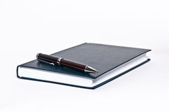 Notebook and pen Stock Photos