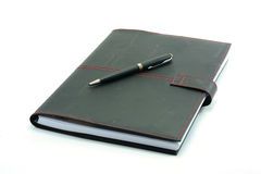 Notebook with pen on a white background Royalty Free Stock Photography