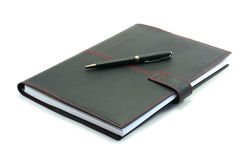 Notebook with pen on a white background Royalty Free Stock Photo