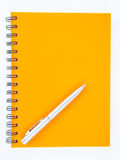 Notebook and pen on white background Royalty Free Stock Photography